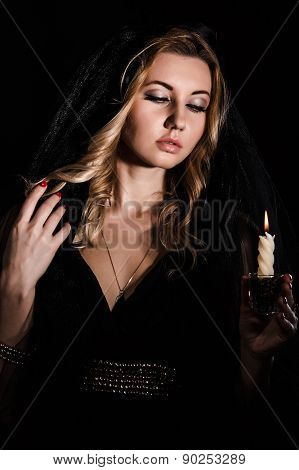 Mysterious Young Woman With A Candle