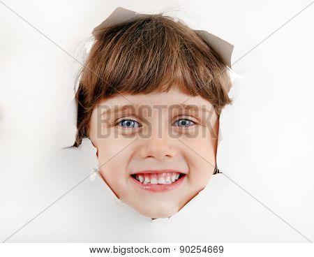 Little Girl Face Through A Paper Hole