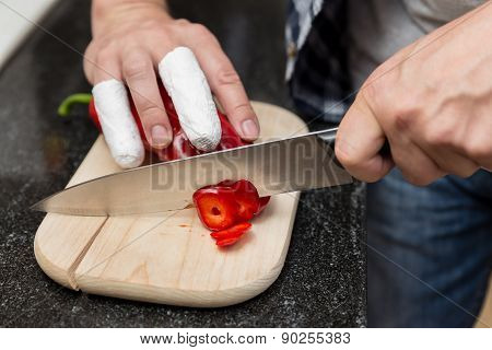 Man Cuts With Injured Fingers Cuts Peppers