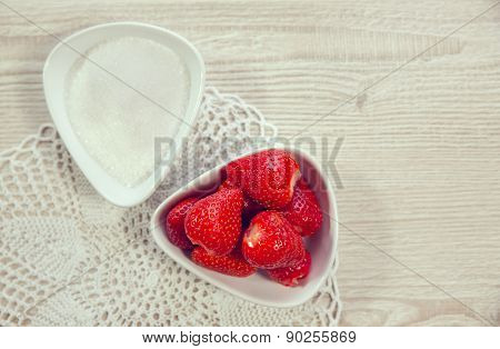Strawberry with sugar. Strawberries in the bowl, sugar in another bowl