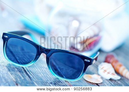 Sun Glasses And Flip Flops