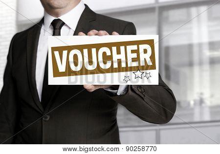 Businessman Holding Sign Voucher To Viewer