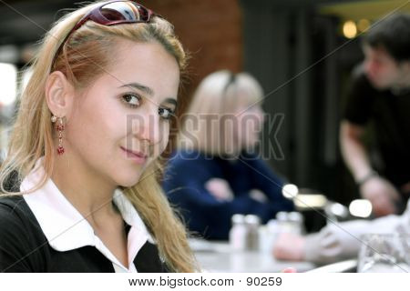 Beautiful Girl In A Restaurant