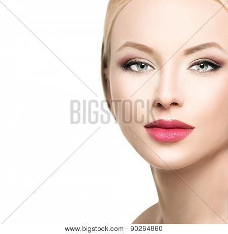 Beautiful blonde woman face close up. Portrait of fashion model with clean skin, bright makeup. Isolated on white background. Beauty female. Skincare. Perfect make up