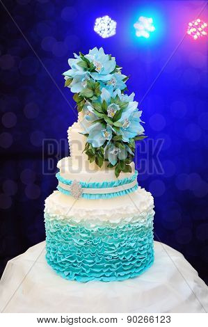 Beautiful Turquoise Three-tiered Wedding Cake On Table