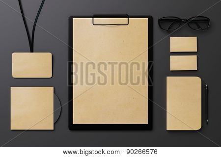 Template For Branding Identity On A Black Table