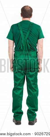 Man in green overalls.