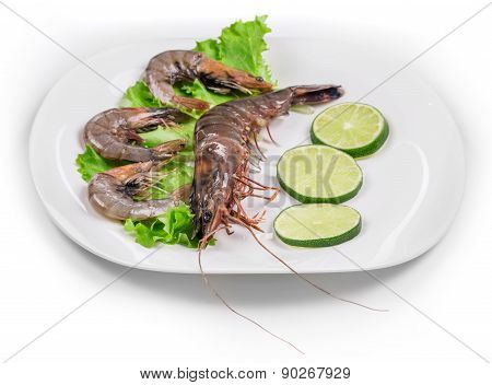 Raw shrimps on plate.