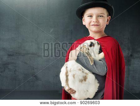 Happy little magician boy