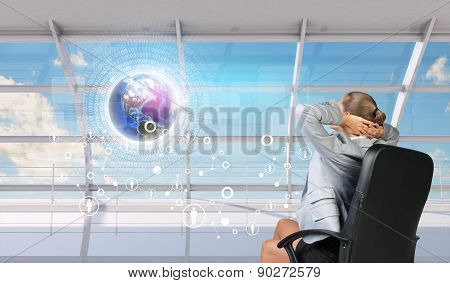 Rear View Of Businesswoman With Hands Behind Head
