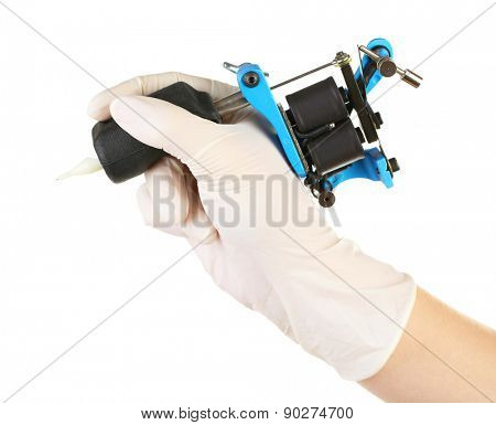 Tattoo artist holding tattoo machine, isolated on white