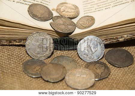 Ancient French Silver Coins With Portraits Of Kings On The Old Cloth