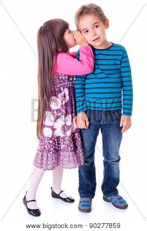 Little Girl Whispering Into Boy's Ear