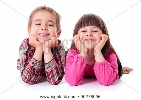 Happy Children Lying On White
