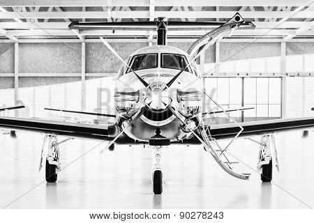 Single Turboprop Aircraft Pilatus Pc-12 In Hangar. Stans, Switzerland, 29Th November 2010.