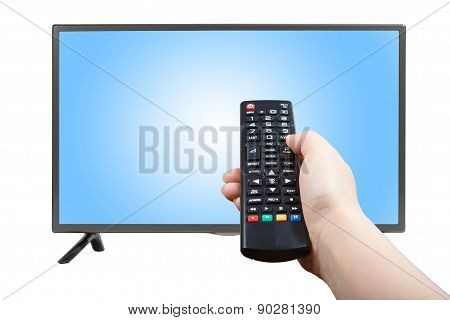 Hand With Remote Control Pointing At Modern Tv Set