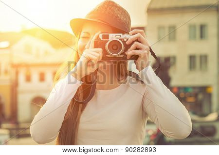 Tourist with photo camera shooting on the street