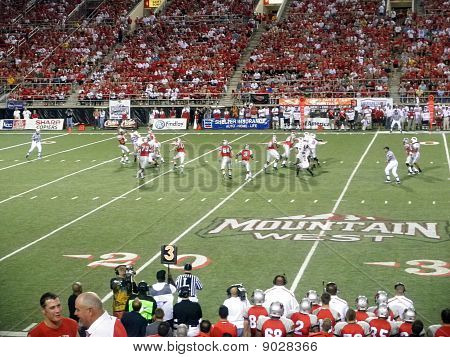 Unlv Quarterback In Motion To Throw Ball With Defender Trying To Block Throw