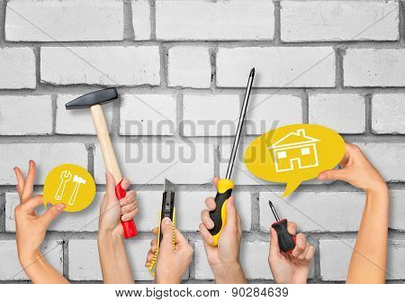 Set Of Peoples Hands Holding Tools
