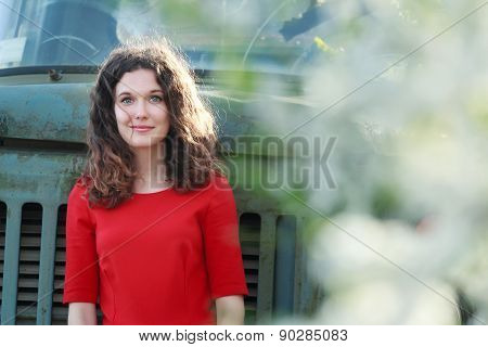 Portrait Of Brunette Girl In Scarlet Dress During Her Spring Vintage Travel