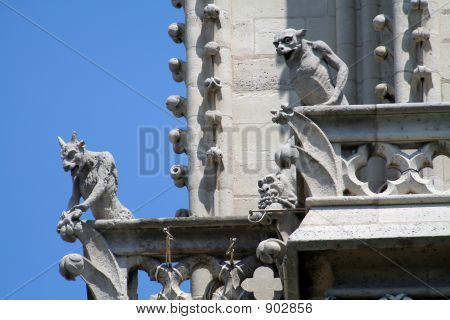 Two Gargoyles On A Balcony