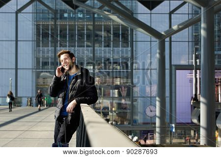 Happy Man Calling By Mobile Phone At Station