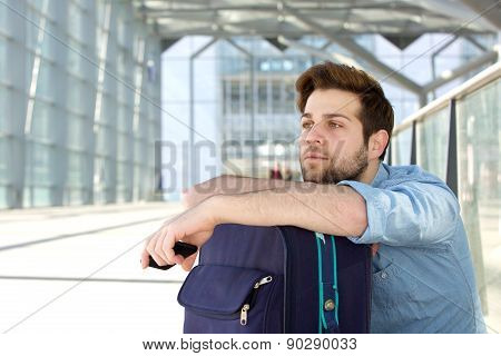 Cool Traveler Waiting At Airport With Bag