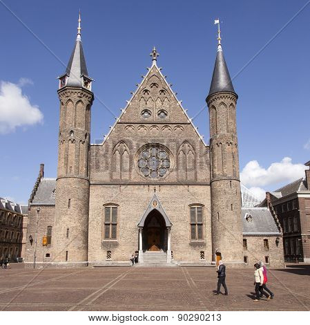 Tourists Walk On Binnenhof In Front Of Ridderzaal In The Hague On Sunny Day In Springtourists Walk O