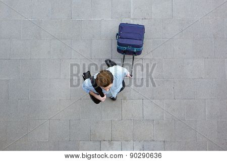 Young Man Walking With Luggage At Airport