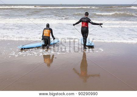 Instructor And Surfer On Scheveningen Beach