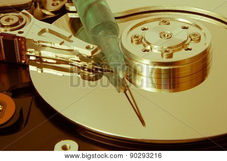 Hdd And A Syringe