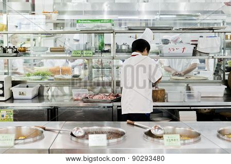 Open chinese commercial kitchen in a restaurant