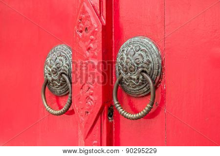Door Knockers Focus On The Right Knocker