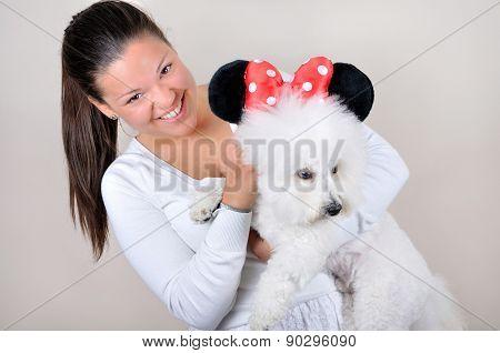 Teenage girl holding the dog