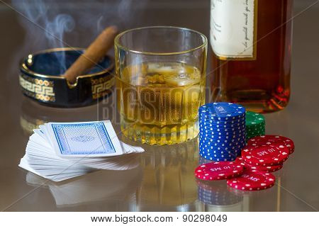 Cards, tokens, whiskey and cigar