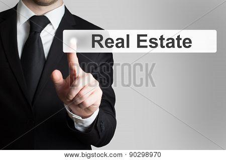 Businessman Pushing Flat Button Real Estate