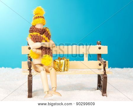 Wooden mannequin on a bench