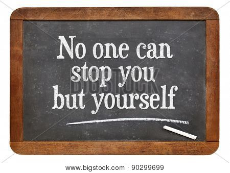 No one can stop you but yourself. Motivational text on a vintage slate blackboard