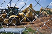 stock photo of chain link fence  - Horizontal Shot of Construction Site With Chain Link Fence - JPG