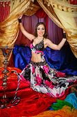 picture of shisha  - Sexy attractive oriental beauty invites the tent - JPG