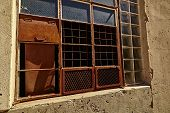 picture of framing a building  - Abandoned building with rusty window frame open - JPG
