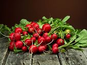 stock photo of radish  - fresh ripe red radish on wooden plank - JPG