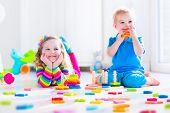 stock photo of girl toy  - Kids playing with wooden toys - JPG