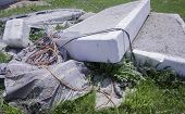 pic of junk-yard  - Bed mattresses and other household garbage in yard - JPG