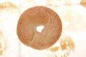 picture of bagel  - three different fresh bagels  over baking paper as background - JPG