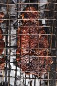 image of charcoal  - grilled roast meats beef lamb fillet ribs on bbq grid over charcoal - JPG
