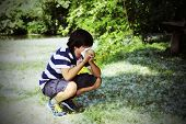 picture of allergy  - young boy with pollen allergy with white handkerchief in hand - JPG