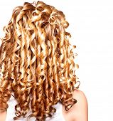Постер, плакат: Beauty girl with blonde curly hair Healthy and long Blond Wavy hair Long permed hair Beautiful yo