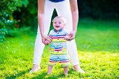 picture of children walking  - Baby boy making his first steps - JPG