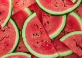picture of watermelon slices  - a fresh ripe watermelon slices as background - JPG
